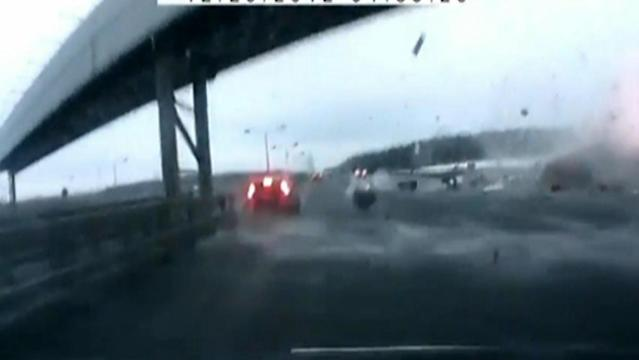 Amateur video shows the moment a plane crashes into a highway in Russia