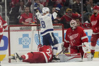 Tampa Bay Lightning left wing Ondrej Palat (18) celebrates his goal against the Detroit Red Wings in overtime during an NHL hockey game Thursday, Oct. 14, 2021, in Detroit. The Lightning won 7-6. (AP Photo/Paul Sancya)