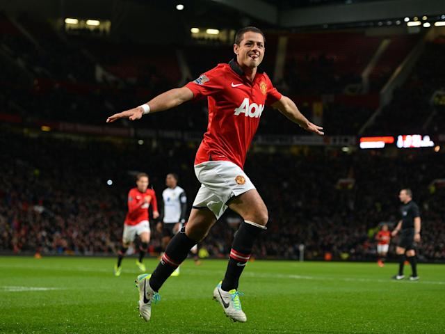 Hernandez celebrates scoring for United during a League Cup clash with Norwich in 2013: Getty