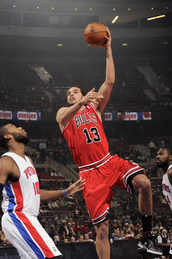 AUBURN HILLS, MI - DECEMBER 7: Joakim Noah #13 of the Chicago Bulls shoots against Greg Monroe #10 of the Detroit Pistons on December 7, 2012 at The Palace of Auburn Hills in Auburn Hills, Michigan. (Photo by J. Dennis/Einstein/NBAE via Getty Images)