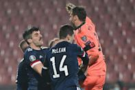 Scotland goalkeeper David Marshall celebrates with his teammates after his penalty save against Serbia sealed their place at Euro 2020