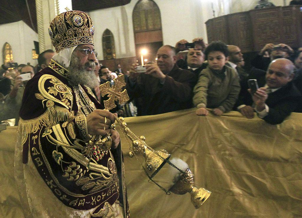 EGYPT: Pope Tawadros II, the 118th Pope of the Coptic Orthodox Church of Alexandria and Patriarch of the See of St. Mark Cathedral, arrives to lead the Coptic Christmas eve mass in Cairo January 6, 2013.
