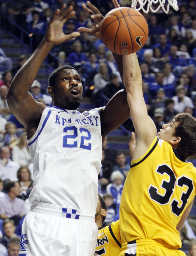 Kentucky's Alex Poythress (22) looses the ball next to Northern Kentucky's Anthony Monaco (33) during the first half of an NCAA college basketball game Sunday, Nov. 10, 2013, in Lexington, Ky. (AP Photo/James Crisp)
