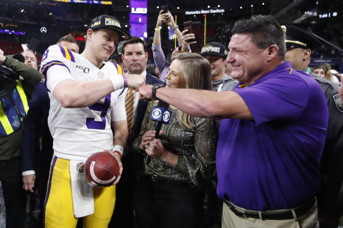LSU quarterback Joe Burrow and LSU head coach Ed Orgeron are the No. 1 team in the final AP poll. (AP Photo/John Bazemore)