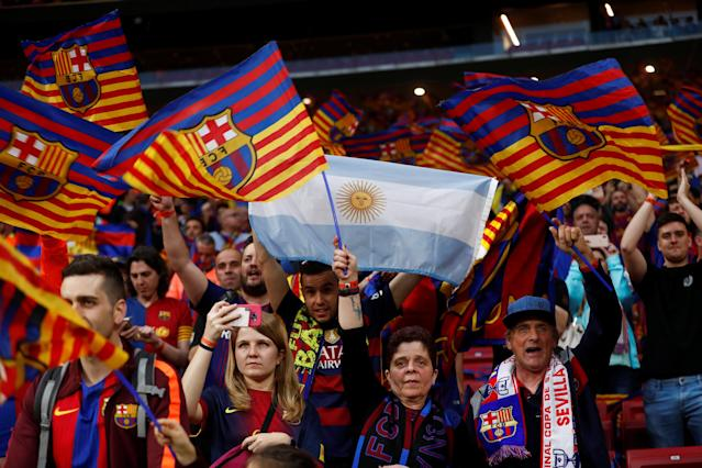 Soccer Football - Spanish King's Cup Final - FC Barcelona v Sevilla - Wanda Metropolitano, Madrid, Spain - April 21, 2018 Barcelona fans with an Argentina flag before the match REUTERS/Juan Medina