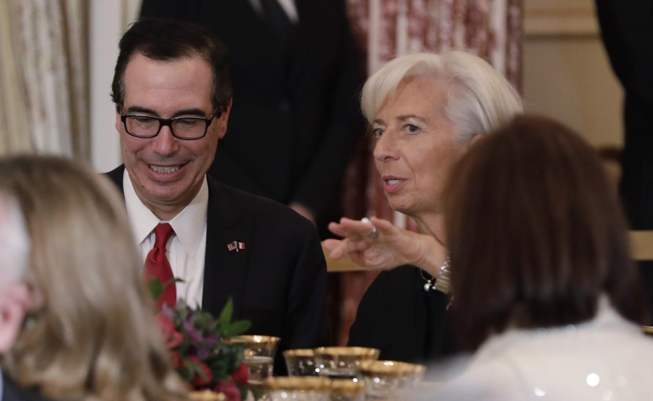 U.S. Treasury Secretary Steven Mnuchin talks with International Monetary Fund (IMF) Managing Director Christine Lagarde at a a luncheon held in French President Emmanuel Macron's honor at the State Department in Washington, U.S., April 24, 2018. REUTERS/Yuri Gripas