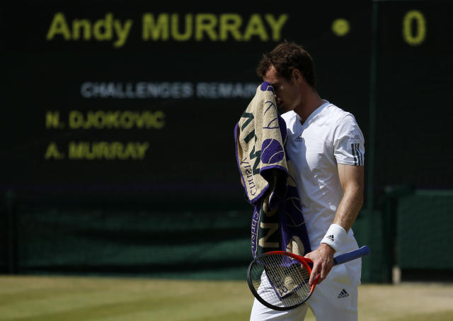 Great Britain's Andy Murray wipes his face in his Men's Final against Serbia's Novak Djokovic during day thirteen of the Wimbledon Championships at The All England Lawn Tennis and Croquet Club, Wimbledon.