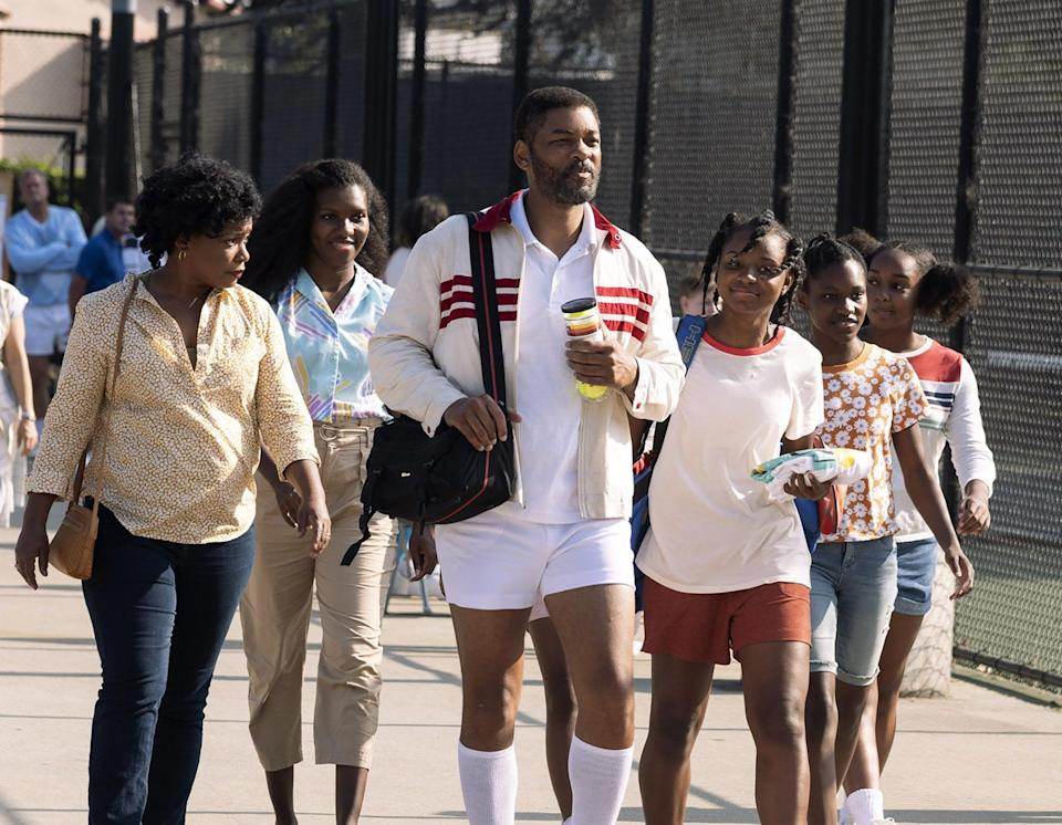 The family walking by tennis courts