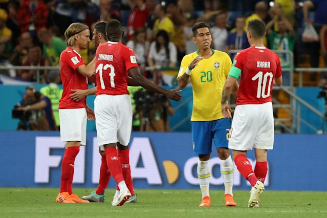 Soccer Football - World Cup - Group E - Brazil vs Switzerland - Rostov Arena, Rostov-on-Don, Russia - June 17, 2018 Brazil's Roberto Firmino shakes hands with Switzerland's Granit Xhaka after the match REUTERS/Marko Djurica