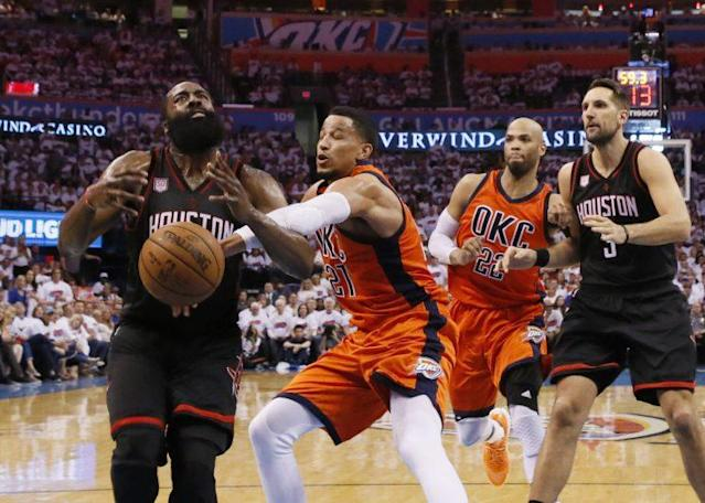 "<a class=""link rapid-noclick-resp"" href=""/nba/players/5196/"" data-ylk=""slk:Andre Roberson"">Andre Roberson</a> will now make eight figures a year to lock dudes like James Harden up. (AP)"