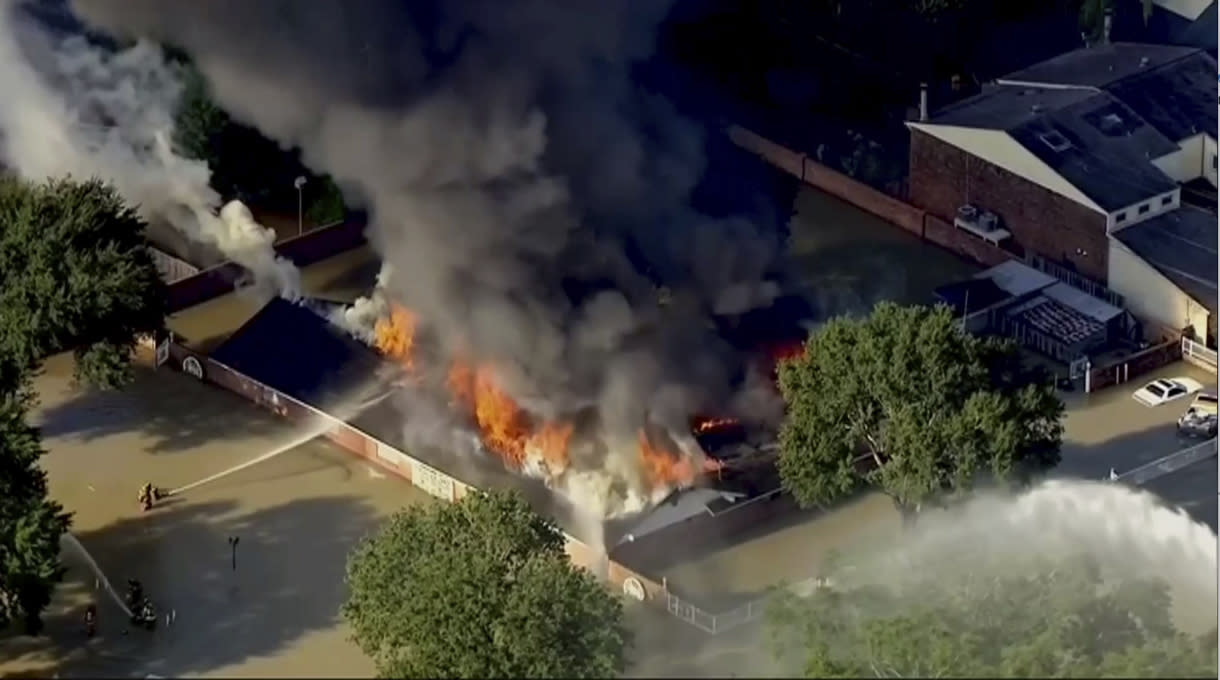 <p>This still image taken from video provided by KTRK-TV shows firefighters battling a blaze at a building still surrounded by Harvey's floodwaters in Houston on Saturday, Sept. 2, 2017. Houston TV station KTRK reported Saturday that firefighters were being hampered by burglar bars on windows around the building, which appears to be a multi-family dwelling. Parts of west Houston are still inundated from the release of floodwater from nearby reservoirs that are designed to catch storm runoff. (Photo: KTRK-TV via AP) </p>