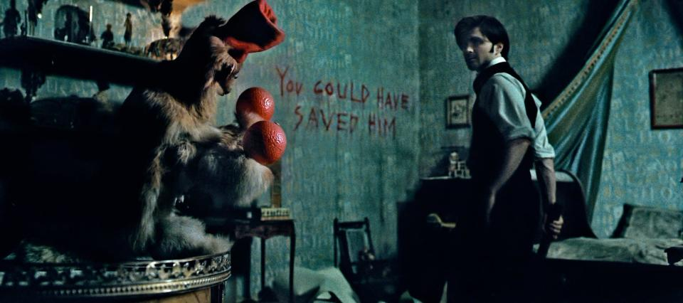 Daniel Radcliffe receives an unwelcome message (Credit: Hammer Films)