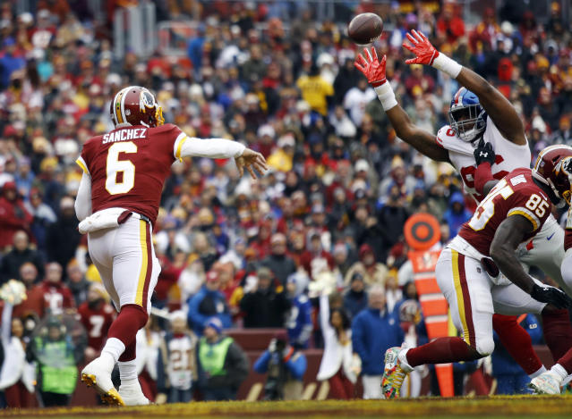 <p>New York Giants outside linebacker Kareem Martin, right, tips a pass by Washington Redskins quarterback Mark Sanchez (6) enabling New York Giants free safety Curtis Riley to intercept the pass and return it for a touchdown, during the first half of an NFL football game Sunday, Dec. 9, 2018, in Landover, Md. (AP Photo/Patrick Semansky) </p>