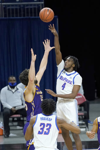 DePaul's Javon Freeman-Liberty (4) shoots over Western Illinois' Will Carius as Pauly Paulicap (33) watches during the second half of an NCAA college basketball game Wednesday, Dec. 23, 2020, in Chicago. (AP Photo/Charles Rex Arbogast)