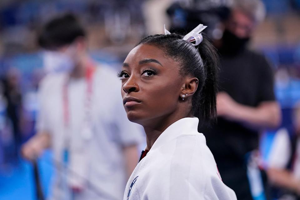 Simone Biles's boyfriend has expressed his support for the gymnast, who withdrew from the Tokyo Olympics (AP)