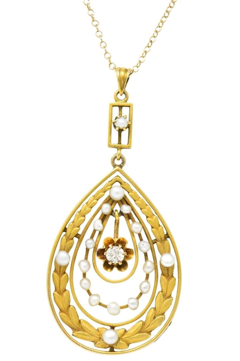 """<p><strong>Wilson's Estate Jewelry</strong></p><p>wilsonsestatejewelry.com</p><p><strong>$900.00</strong></p><p><a href=""""https://www.wilsonsestatejewelry.com/products/art-nouveau-diamond-seed-pearl-14-karat-gold-pendant-necklace-jewellery-locket-fashion?variant=13236531888151¤cy=USD"""" rel=""""nofollow noopener"""" target=""""_blank"""" data-ylk=""""slk:Shop Now"""" class=""""link rapid-noclick-resp"""">Shop Now</a></p><p>Both refined and ornate, the center of this piece is an articulated belcher-set old mine cut diamond in an open drop motif. The gold matte foliate motif with pearl embellishment is the perfect pretty accent to the piece which dates back to 1900. </p>"""