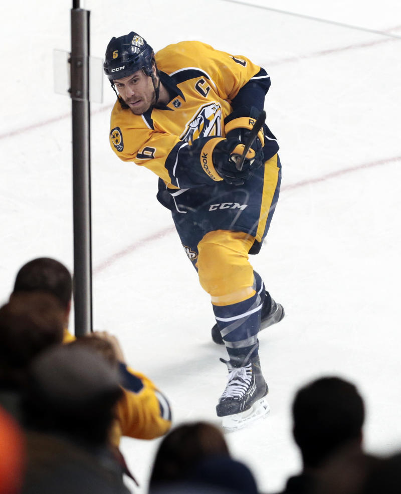 Predators captain Shea Weber hit in face by puck