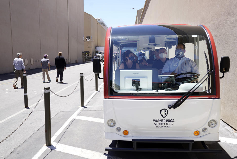 A tour guide drives visitors through the Warner Bros. lot during the Warner Bros. Studio Tour Hollywood media preview on June 24, 2021, in Burbank, Calif. (AP Photo/Chris Pizzello)
