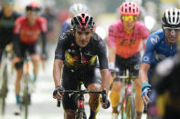 Richard Carapaz of Ecuador, center, and Spain's Enric Mas, right, cross the finish line of the eighth stage of the Tour de France cycling race over 150.8 kilometers (93.7 miles) with start in Oyonnax and finish in Le Grand-Bornand, France,Saturday, July 3, 2021. (AP Photo/Daniel Cole)