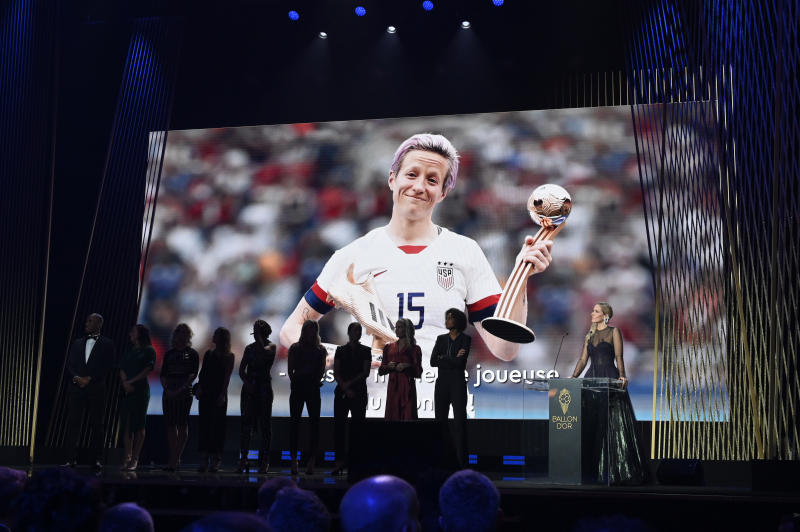 PARIS, FRANCE - DECEMBER 02: Megan Rapinoe, who was unable to except her award in person, wins the Ballon D'Or award during the Ballon D'Or Ceremony at Theatre Du Chatelet on December 02, 2019 in Paris, France. The 2019 female nominees pose onstage in her absence. (Photo by Kristy Sparow/Getty Images)