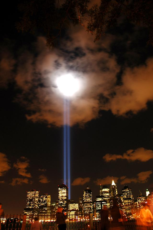 Two lights shining from West and Morris streets in Manhattan honor the World Trade Center Twin Towers in 'A Tribute in Light' on September 11, 2006. (Photo by Wayne Isaak/WireImage)