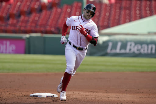 Boston Red Sox's Michael Chavis runs the bases toward home after hitting a two-run home run off a pitch by New York Yankees' Deivi Garcia in the second inning of a baseball game Sunday, Sept. 20, 2020, in Boston. (AP Photo/Steven Senne)