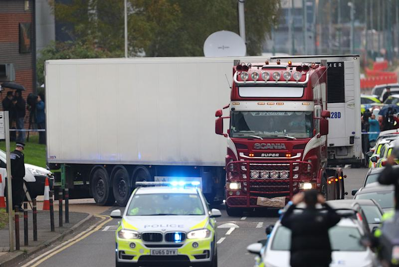 The container lorry where 39 people were found dead inside leaves the industrial estate on Wednesday afternoon, where it was to be moved to a secure location.