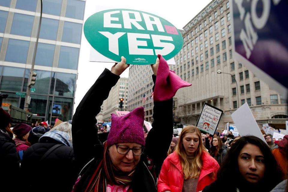 A demonstrator holds a sign supporting the Equal Rights Amendment in Washington DC on 19 January.