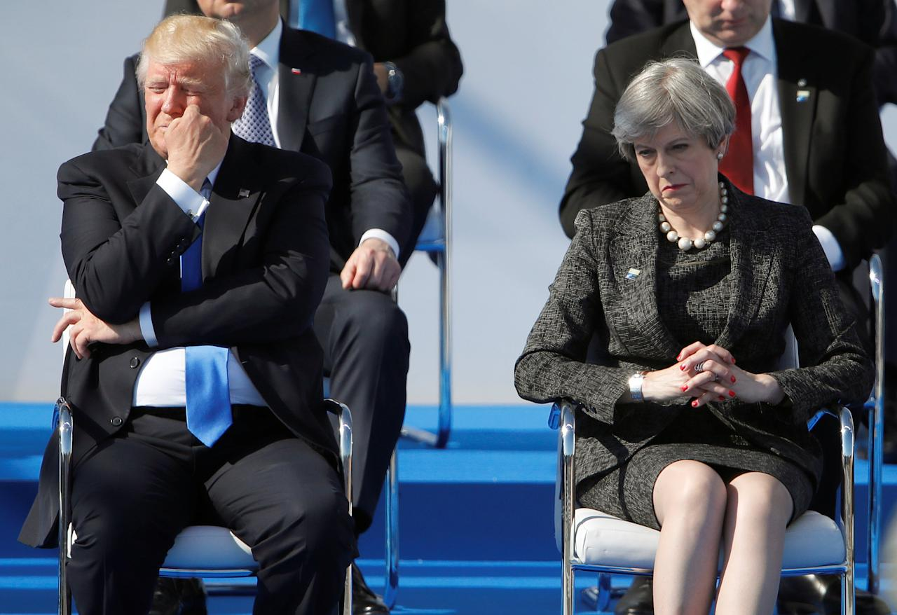 U.S. President Donald Trump (L) and Britain's Prime Minister Theresa May react during a ceremony at the new NATO headquarters before the start of a summit in Brussels, Belgium, May 25, 2017.    REUTERS/Christian Hartmann     TPX IMAGES OF THE DAY