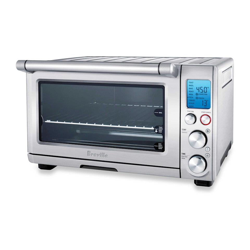 <p>Until your double-oven dreams become a reality, this <span>Breville The Smart OvenTM Convection Toaster Oven</span> ($270) is the next-best thing.</p>