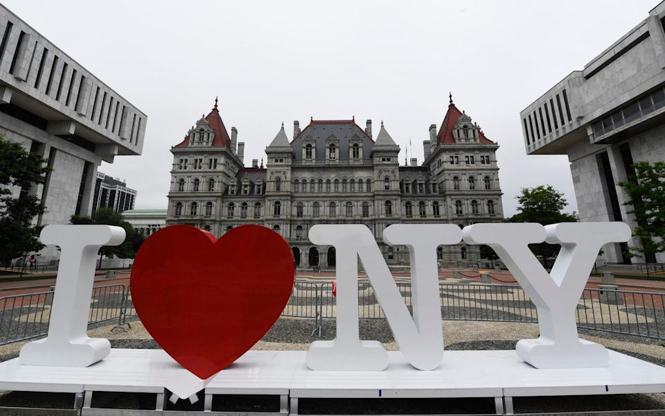 An I Love NY sign in front of the New York state Capitol in Albany, NY - Hans Pennink/Ap