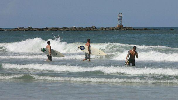 PHOTO: Surfers hit the waves at New Smyrna Beach in Florida, Aug. 29, 2007. (Orlando Sentinel/MCT via Getty Images, FILE)