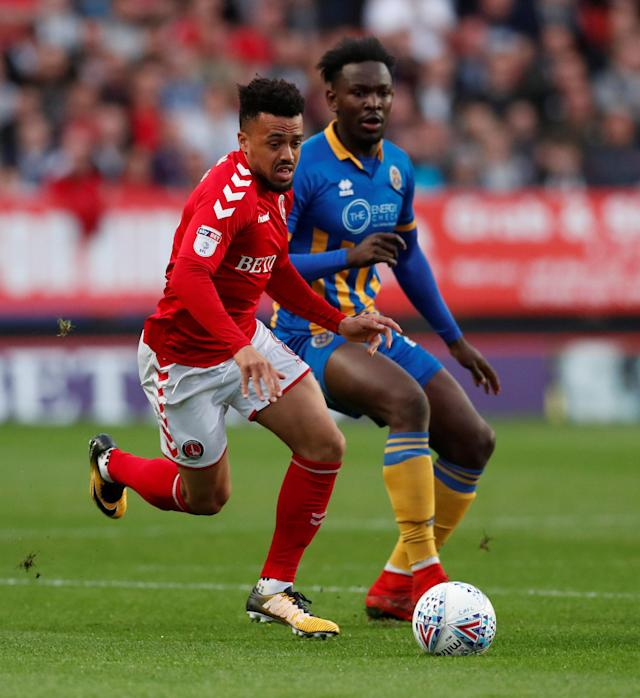 "Soccer Football - League One Play Off Semi Final First Leg - Charlton Athletic vs Shrewsbury Town - The Valley, London, Britain - May 10, 2018 Charlton Athletic's Nicky Ajose in action with Shrewsbury Town's Aristote Nsiala Action Images/Peter Cziborra EDITORIAL USE ONLY. No use with unauthorized audio, video, data, fixture lists, club/league logos or ""live"" services. Online in-match use limited to 75 images, no video emulation. No use in betting, games or single club/league/player publications. Please contact your account representative for further details."