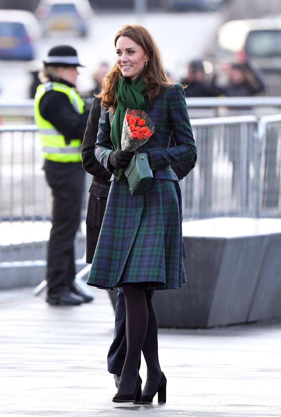 To open the V&A Dundee, the Duchess of Cambridge flew the Scottish flag in an Alexander McQueen Black Watch tartan coat dress – she first wore the look on St. Andrew's Day in November 2012. Black Tod's pumps and a Manu Atelier handbag finished the ensemble. [Photo: Getty]