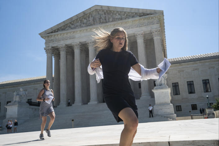 News agency interns sprint across the plaza at the Supreme Court with copies of the justices' final decisions of the term, in Washington, Thursday, June 27, 2019.  (Photo: J. Scott Applewhite/AP)
