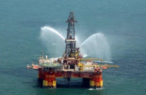 Iran's offshore oil platform in the Caspian Sea. The United States has exempted China and Singapore from sanctions over purchases of oil from Iran hours before a deadline, saying that major economies were united in pressuring Tehran