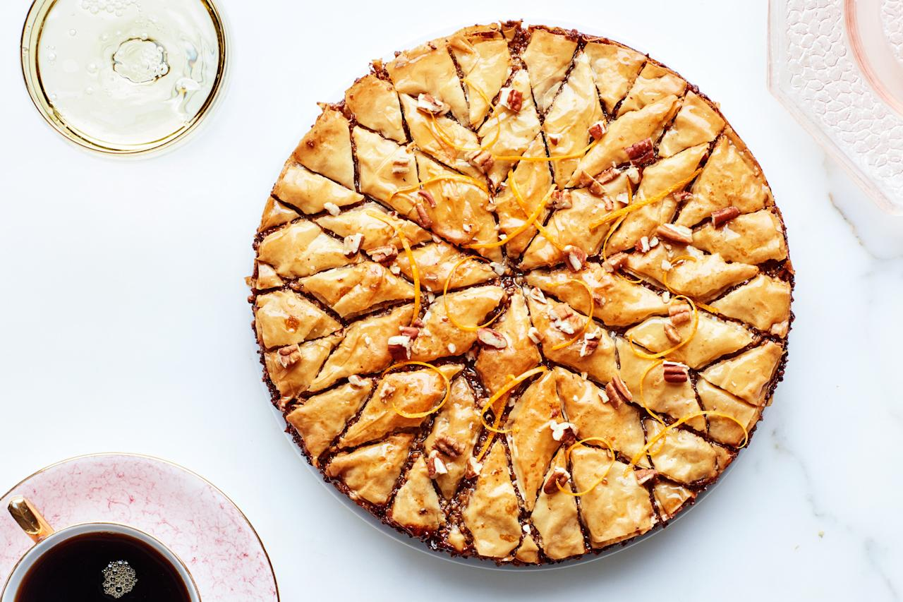 """Bourbon-honey syrup and fragrant orange zest add rich flavor to this perfect Father's Day dessert. <a href=""""https://www.epicurious.com/recipes/food/views/pecan-orange-baklava-pie?mbid=synd_yahoo_rss"""">See recipe.</a>"""