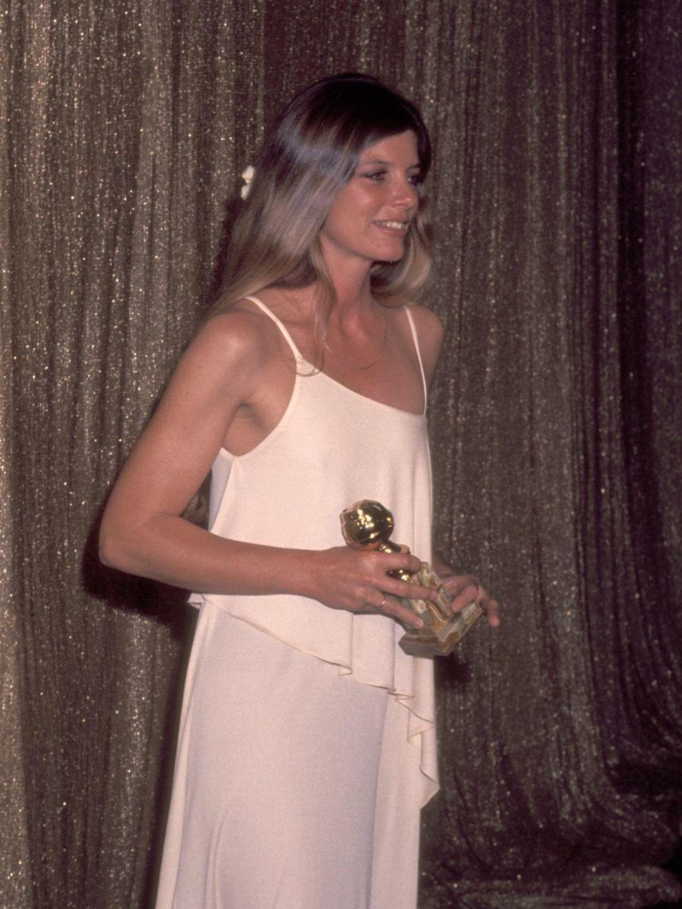 <p>Katharine wore a chic white asymmetrical gown and took home her second Golden Globe in 1977 for her supporting actress role in <em>Voyage of the Damned</em>. </p>
