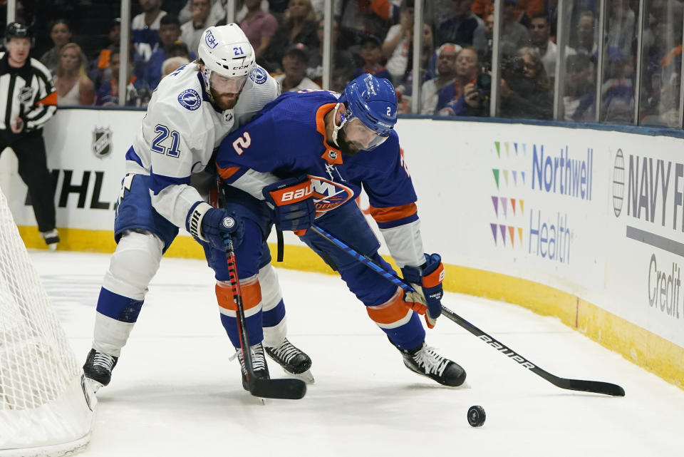 New York Islanders defenseman Nick Leddy (2) keeps control of the puck against Tampa Bay Lightning center Brayden Point (21) during the first period of Game 3 of the NHL hockey Stanley Cup semifinals, Thursday, June 17, 2021, in Uniondale, N.Y. (AP Photo/Frank Franklin II)