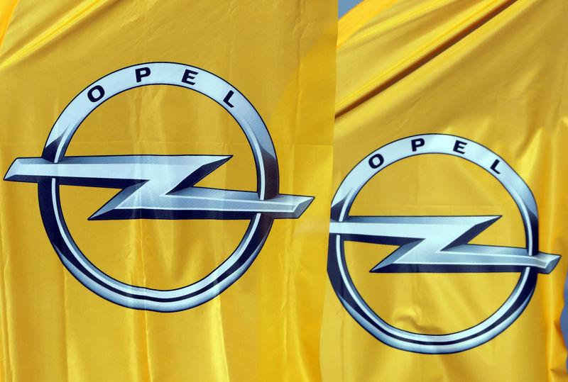 Logos of German car maker Opel are seen on banners at a dealership in Nice