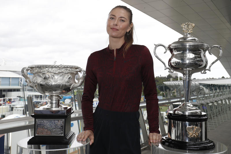 Maria Sharapova poses with the Australian Open trophies ahead of the 2020 Australian Open.