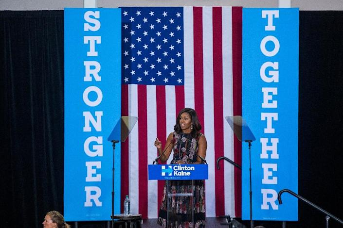 First Lady Michelle Obama campaigns for Democratic presidential candidate Hillary Clinton at George Mason University September 16, 2016 in Fairfax, Virginia (AFP Photo/Zach Gibson)