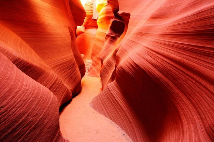 "<p><a href=""https://www.antelopecanyon.com/"" rel=""nofollow noopener"" target=""_blank"" data-ylk=""slk:Antelope Canyon"" class=""link rapid-noclick-resp"">Antelope Canyon</a> can be recognized from Microsoft and Apple desktop backgrounds, as well as where Britney Spears shot her music video for <a href=""https://www.youtube.com/watch?v=IlV7RhT6zHs"" rel=""nofollow noopener"" target=""_blank"" data-ylk=""slk:""I'm Not a Girl, Not Yet a Woman."""" class=""link rapid-noclick-resp"">""I'm Not a Girl, Not Yet a Woman.""</a> </p><p>The canyon is split between upper and lower levels, and unless you're visiting for more than a day you can only visit one. Visitation requires months of preparation and purchasing tickets, as this is located on Navajo land. </p><p>The canyon looks totally different depending on the time of day, and there are tour groups for advanced photographers too. </p>"
