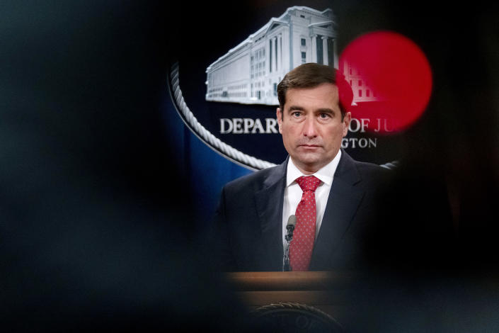 """FILE - In this Oct. 19, 2020, file photo Assistant Attorney General for the National Security Division John Demers takes a question from a reporter via teleconference at a news conference at the Department of Justice in Washington. The damned-if-you-pay-damned-if-you-don't dilemma on ransomware payments has left U.S. officials fumbling about how to respond. In April, the then-top national security official in the Justice Department, John Demers, was lukewarm toward banning payments, saying it could put """"us in a more adversarial posture vis-à-vis the victims, which is not where we want to be."""" (AP Photo/Andrew Harnik, Pool)"""