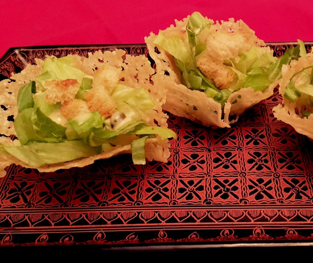 """<p>""""We took one of our family favorites, our Vegetarian Caesar Salad, and made it into a delicious and delightful party appetizer. The crispy Parmesan cup serves as the bowl for the crunchy romaine, tangy dressing, and mini croutons. <a href=""""http://www.ediblefeast.com/recipes/mini-vegetarian-caesar-salad-parmesan-cups"""">Here's a salad you can happily eat by hand.</a>"""" –Corky, Lori, Dana and Tracy Pollan, <a href=""""http://pollanfamilytable.com"""">The Pollan Family Table</a></p><p><i>(Photo: Pollan Family Table)</i><br /></p>"""