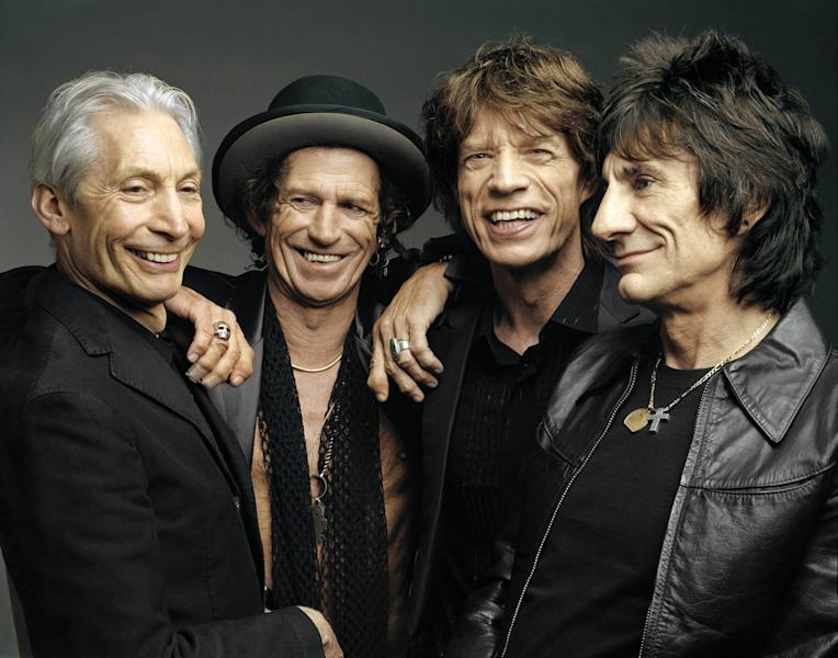 "FILE - This 2005 file photo, originally supplied by the Rolling Stones, shows members of the group, from left, Charlie Watts, Keith Richards, Mick Jagger, and Ron Wood posing during a photo shoot. The Rolling Stones have called off their tour dates in Australia and New Zealand following the death of Mick Jagger's girlfriend and designer L'Wren Scott on Monday, March 17, 2014. The iconic band says in a statement Tuesday they ""are deeply sorry and disappointed to announce the postponement of the rest of their 14 ON FIRE tour."" (AP Photo/The Rolling Stones, Mark Seliger-File)"