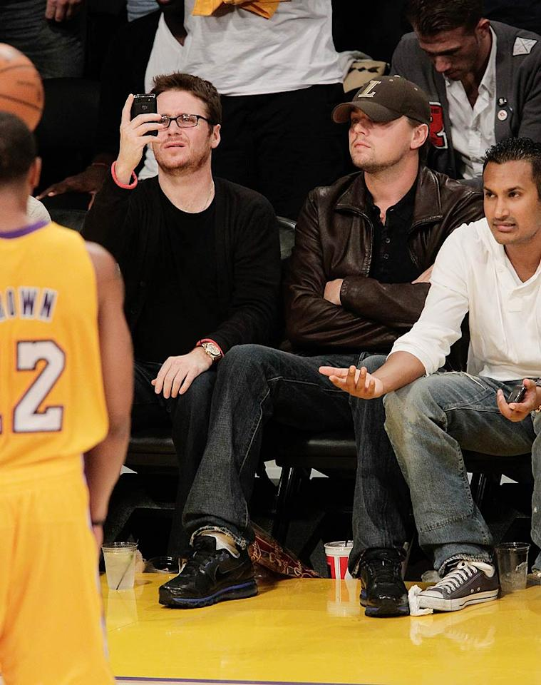 "Die-hard Lakers devotee Leonardo DiCaprio was all business while watching the action. Meanwhile, ""Entourage's"" Kevin Connolly was busy playing with his cell phone. Noel Vasquez/<a href=""http://www.gettyimages.com/"" target=""new"">GettyImages.com</a> - October 26, 2010"