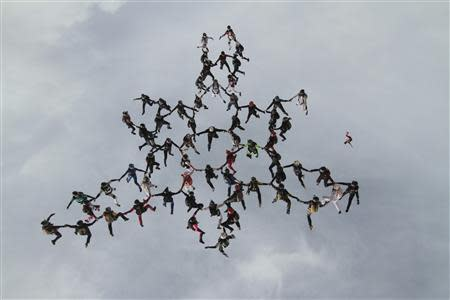 Handout of 63 women linking hands to break world vertical skydiving record in Eloy, Arizona