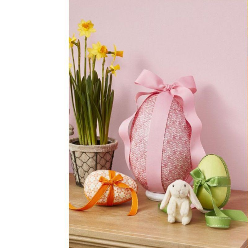 "<p>Create an oversized egg with a twist! Open an <a href=""https://www.amazon.com/Ready-Decorate-Paper-Mache-Boxes/dp/B06XQN4NM3/ref=sr_1_2?tag=syn-yahoo-20&ascsubtag=%5Bartid%7C10070.g.2216%5Bsrc%7Cyahoo-us"" rel=""nofollow noopener"" target=""_blank"" data-ylk=""slk:egg box"" class=""link rapid-noclick-resp"">egg box</a>, paint it white, then let dry. Starting at the top of one egg half, apply <a href=""https://www.amazon.com/Rolls-Decorative-Masking-Crafts-Wrapping/dp/B06XNJH7YK?tag=syn-yahoo-20&ascsubtag=%5Bartid%7C10070.g.2216%5Bsrc%7Cyahoo-us"" rel=""nofollow noopener"" target=""_blank"" data-ylk=""slk:washi tape"" class=""link rapid-noclick-resp"">washi tape</a> lengthwise one row at a time, trimming at the ends. Repeat this on other half until it's covered, then fill with <a href=""https://www.amazon.com/gp/product/B00710KGME/ref=ppx_yo_dt_b_asin_title_o05__o00_s03?ie=UTF8&psc=1&tag=syn-yahoo-20&ascsubtag=%5Bartid%7C10070.g.2216%5Bsrc%7Cyahoo-us"" rel=""nofollow noopener"" target=""_blank"" data-ylk=""slk:toys"" class=""link rapid-noclick-resp"">toys</a> or candy, close, and tie with a ribbon.</p>"