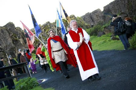 High priest of the Asatru Association, Hilmar Orn Hilmarsson, leads a procession of fellow members of the Asatru Association, a contemporary Icelandic pagan society, at the Pingvellir National Park near Reykjavik June 21, 2012.   REUTERS/Silke Schurack